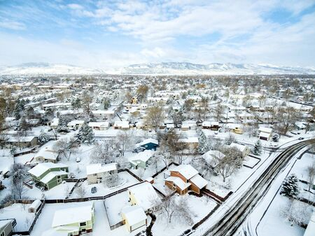 fort collins: Fort COllins cityscape - aerial  view of typical residential neighborhood along Front Range of Rocky Mountains in Colorado, late winter  or early spring scenery with snow. Stock Photo