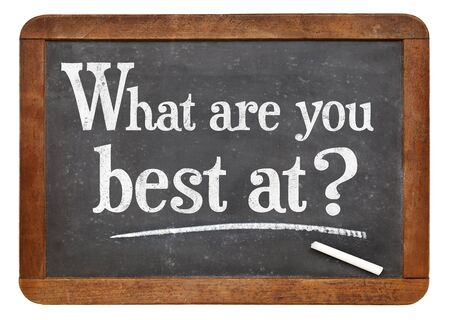 WHat are you best at?  A question in white chalk on a vintage slate blackboard