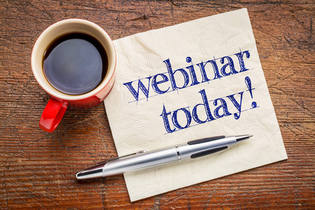 webinar today reminder - handwriting on a napkin with cup[ of coffee Foto de archivo