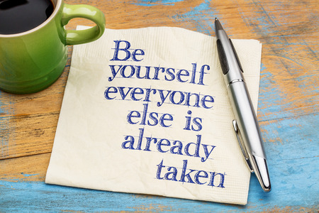 yourself: be yourself advice - handwriting on a napkin with cup[ of coffee