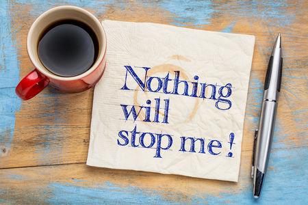 unstoppable: Nothing will stop me - handwriting on a napkin with a cup of coffee -determination concept