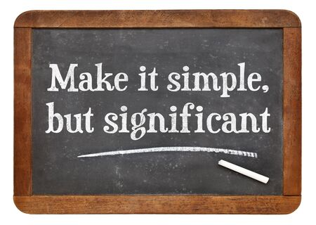 significant: Make it simple, but significant - white chalk text on a vintage slate blackboard Stock Photo