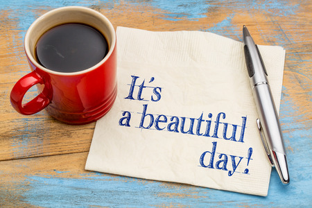 good mood: It is a beautiful day! Handwriting on a napkin with a cup of coffee - good mood concept