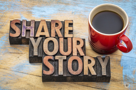 and share: share your story  word abstract - inspirational text in vintage letterpress wood type with a cup of coffee - storytelling concept