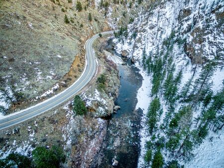fort collins: aerial view of Cache la Poudre River at Big Narrows west of  Fort Collins in northern Colorado - winter scenery with the colorado highway 14 Stock Photo