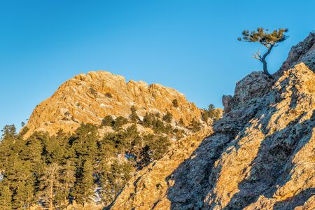 collins: Horsetooth Rock - a landmark of Fort Collins in northern Colorado, winter scenery with traces of snow