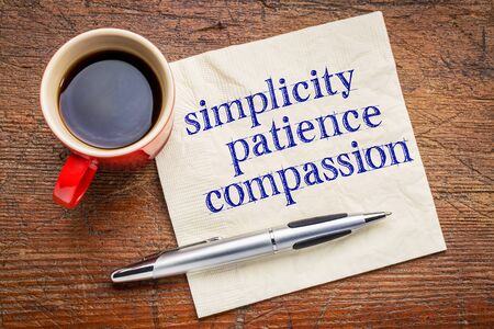 simplicity, patience, compassion - three words from Buddha teaching - handwriting on a napkin with cup of coffee against gray slate stone background 스톡 콘텐츠