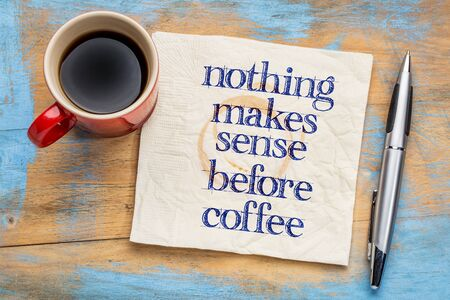 sense: Nothing makes sense before coffee - handwriting on a napkin with cup of coffee against grunge wood background Stock Photo