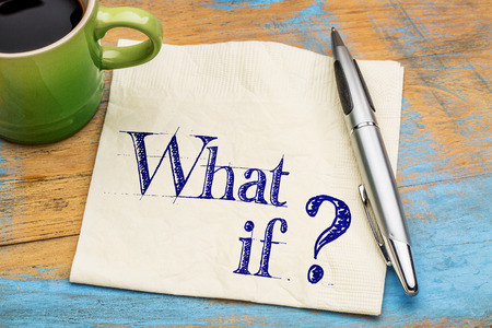 what if: What if question - handwriting on napkin with a cup coffee against grunge painted wood
