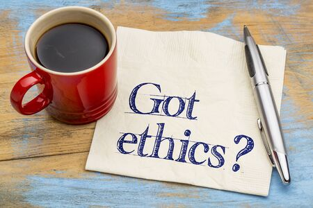 ethics and morals: Got ethics? Are you ethical question. Handwriting on a napkin with cup of coffee.