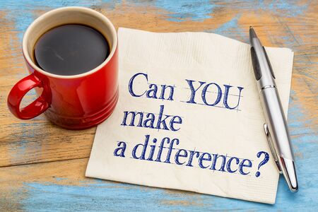 difference: Can you make a difference? A motivational  question on a napkin with a cup of coffee
