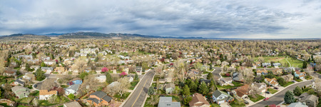 fort collins: aerial panorama of Fort Collins in northern Colorado - residential buildings with Rocky Mountains foothills in background, early spring scenery Stock Photo