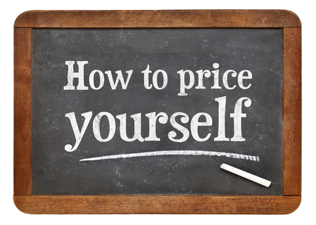 how to: How to price yourself  - white chalk text on a vintage slate blackboard