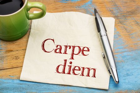 existential: Carpe diem - handwriting on a napkin with a cup of coffee Stock Photo