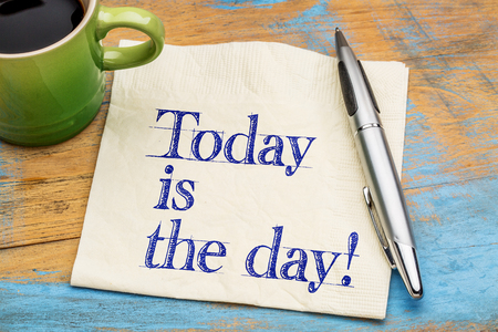 today is the day reminder on a napkin with a cup of coffee
