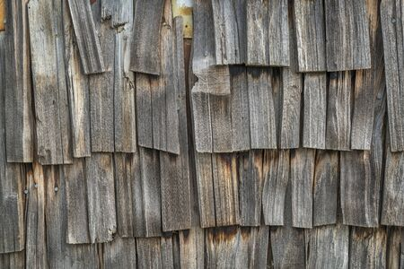 shingles: weathered wooden shingles - old biulding wall background