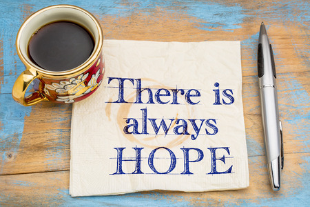 there is always hope - handwriting on a napkin with a cup of espresso coffee
