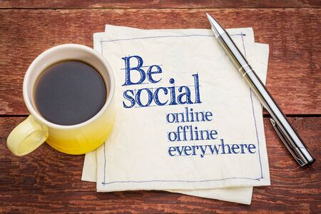 Be social online, offline, everywhere - handwriting on a napkin with a cup of coffee