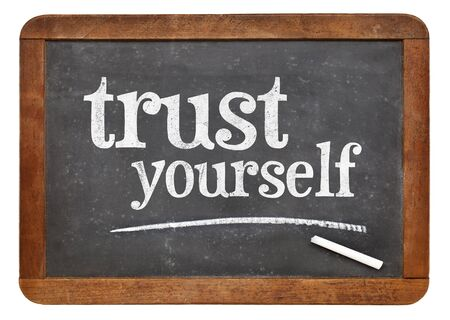 yourself: Trust yourself  - white chalk text on a vintage slate blackboard