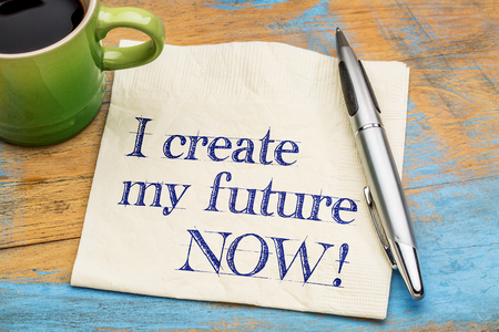 affirmation: I create my future now - positive affirmation - handwriting on  napkin with a cup of coffee
