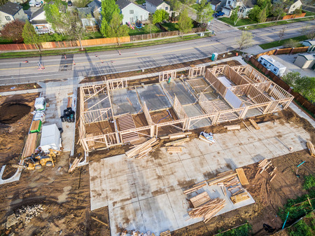 mud house: FORT COLLINS, CO, USA - May 8 2016: Aerial  view of building construction, lumber and machinery at Manhattan Ave in Fort Collins, Colorado