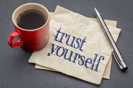 yourself: Trust yourself advice - handwriting on a napkin with a cup of coffee Stock Photo