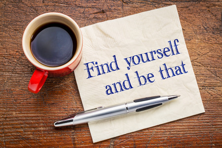 self discovery: Find yourself and be that -self discovery concept - handwriting on a napkin with cup of coffee