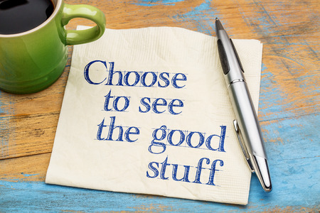 stuff: Choose to see good stuff - positive advice - handwriting on a napkin with cup of coffee