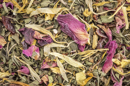 Macro of healthy stomach herbal tea -  a blend of  peppermint, spearmint, ginger, hisbiscus, rosehip, red rose,, almond, and osmanthus.