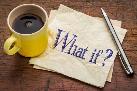 what if: What if question - handwriting on napkin with a yellow cup of espresso coffee against rustic wood