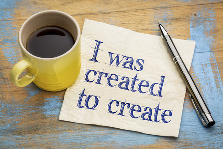 affirmation: I was created to create positive affirmation note - - handwriting on a napkin with a cup of espresso coffee