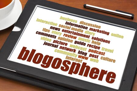 blogosphere: blogosphere word cloud on a digital tablet with a cup of tea - blogging concept Stock Photo