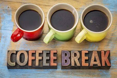 coffee break banner  in vintage letterpress wood type with three cups of espresso coffee