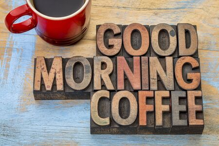 woodtype: Good morning coffee banner in vintage letterpress wood type blocks with a cup of coffee Stock Photo