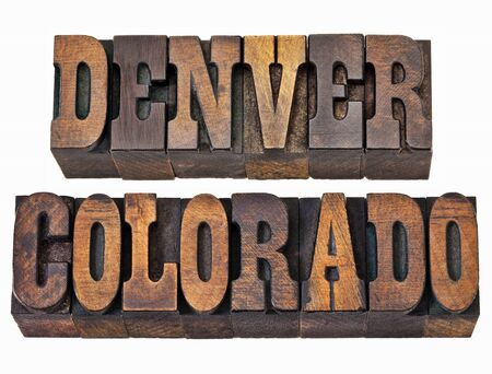 capital of colorado: Denver and Colorado - isolated word in vintage rustic letterpress wood type - French Clarendon font popular in western movies and memorabilia Stock Photo