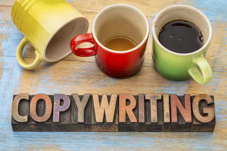 copywriting concept  - text in vintage letterpress wood type printing blocks with three cups of coffee Stock Photo
