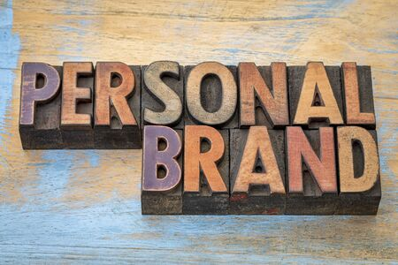 brands: Personal brand word abstract - text in vintage letterpress wood type printing blocks Stock Photo