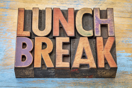 lunch break banner - text in vintage letterpress wood type printing blocks against grunge painted wood