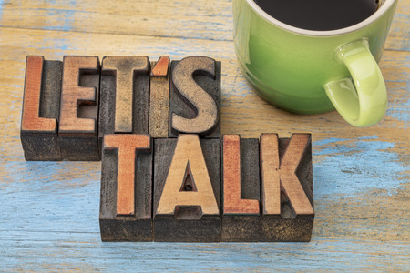 talk: Let us talk invitation  - text in vintage letterpress wood type block with a cup of coffee Stock Photo