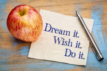 Dream it, Wish it, Do it, Handwriting on a napkin with a fresh apple,