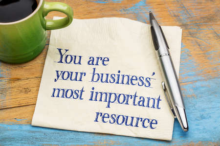 important reminder: You are your business most important resource - reminder handwriting on a napkin with a cup of coffee Stock Photo