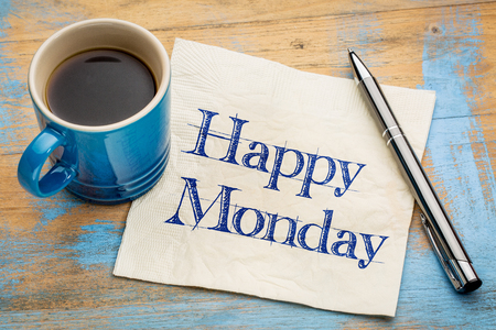 Happy Monday -  cheerful handwriting on a napkin with a cup of coffee Stockfoto