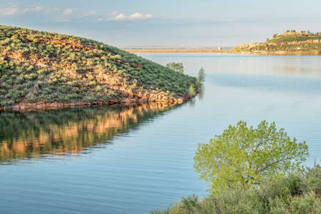 horsetooth rock: Horsetooth Reservoir with one of rock dams (Soldier Dam) at springtime, Fort Collins, Colorado Stock Photo