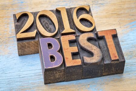 letterpress type: 2016 best sign -  text in vintage letterpress wood type blocks stained by color inks