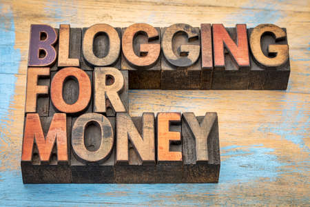 monetizing: blogging for money - internet and entrepreneur concept - text in vintage letterpress wood type stained by color inks Stock Photo