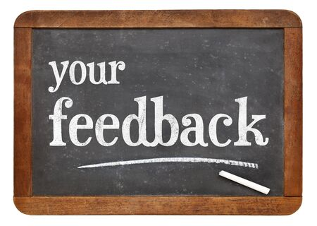 your feedback  sign - white chalk text on a vintage slate blackboard