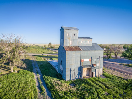 dismounted: GROVER,  CO, USA - JUNE4, 2016:  Historic Grover Grain Elevator (circa 1916),  a well-preserved example of cribbed construction  in the Pawnee Grassland Region.  The railroad right-of-way is still visible next to it (dismounted in 1975) Editorial