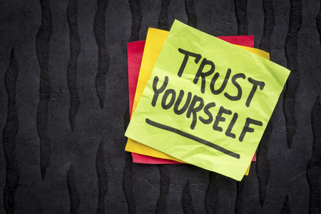yourself: trust yourself reminder note - handwriting on a sticky note against black Nepalese lokta paper