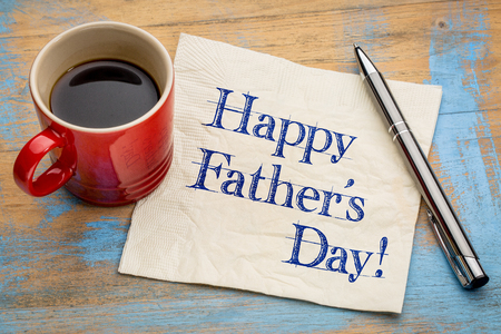 paternal: happy fathers day - handwriting on a napkin  with a cup of coffee