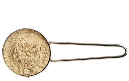 adaptogen: red maca root powder on a metal measuring scoop isolated on white